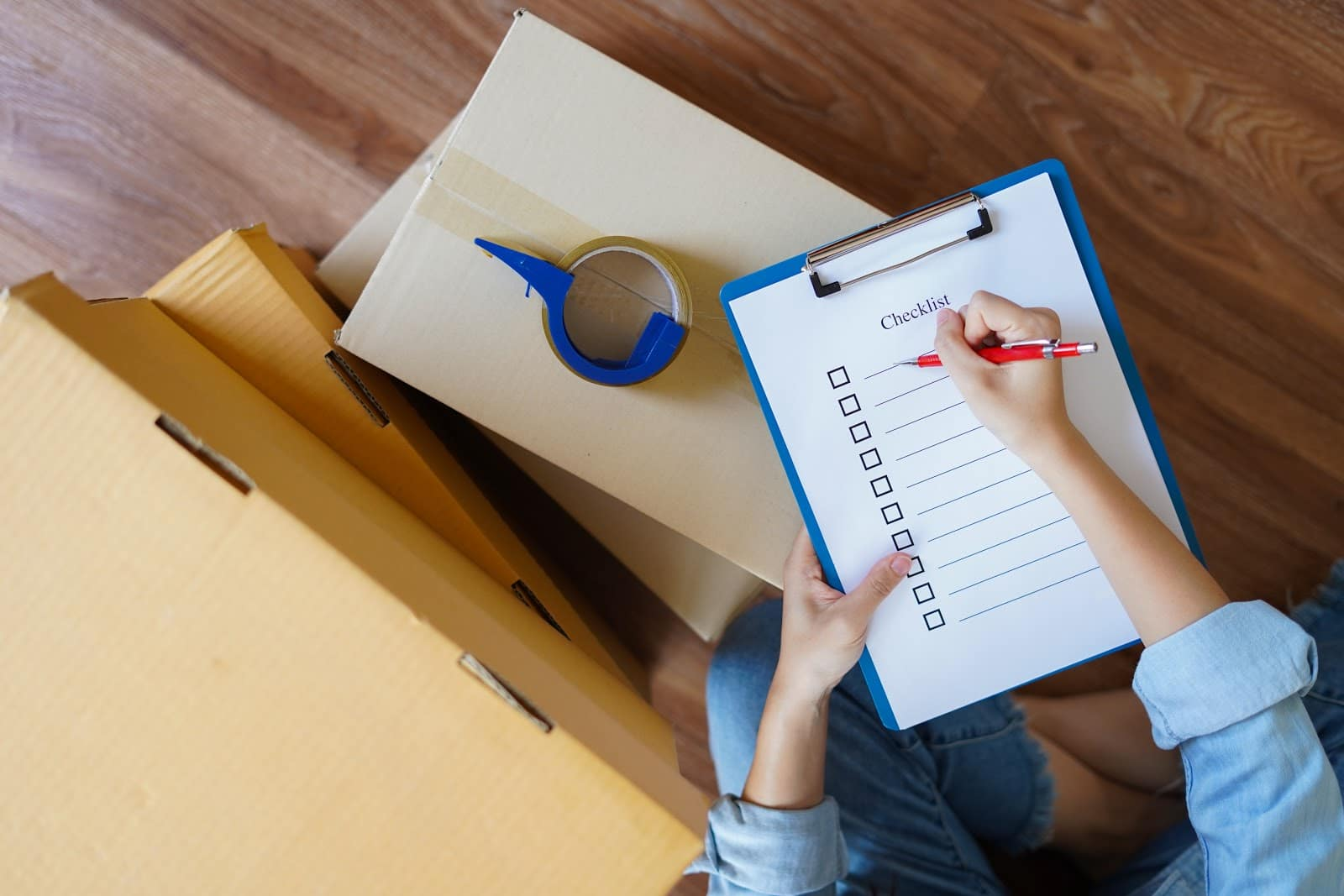 woman writing relocation checklist