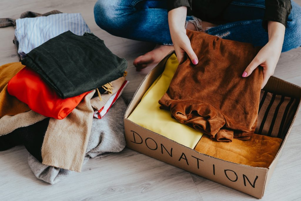 woman decluttering for house move by folding clothes