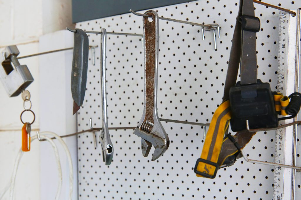 DIY tools hanging from pegboard storage